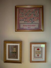 three embroideries framed